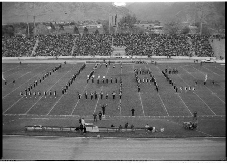 Series of photographs of the 1965 Homecoming marching band half-time show