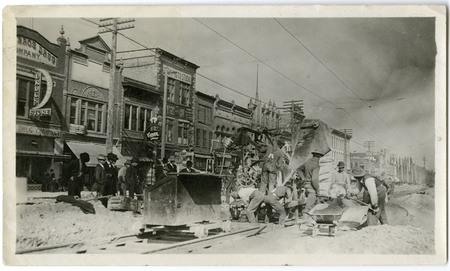 Men working on railway tracks on Logan, Utah's Main Street (2/2)