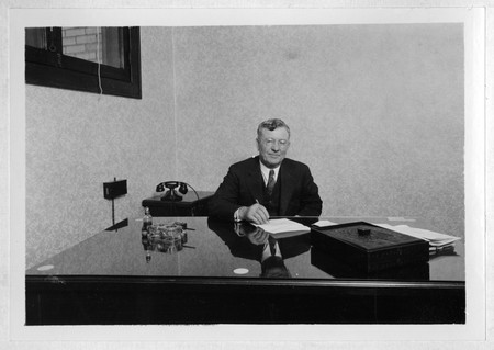 Herschel Bullen sitting at his desk.