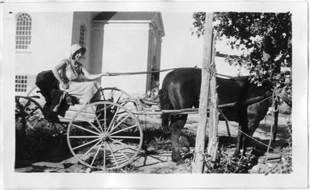 Mrs Olsen in her buggy