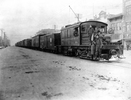 O.L.I. Freight Train #901 stops on Main Street in Logan, Utah<br />