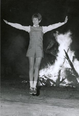 Songleader, probably Linda Watterson, cheering, circa 1969