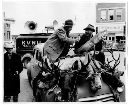 Reed Bullen interviewing a man in downtown Logan, c. 1945.