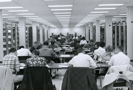 Students at study tables on second floor of Merrill Library, circa 1964 (1 of 2)